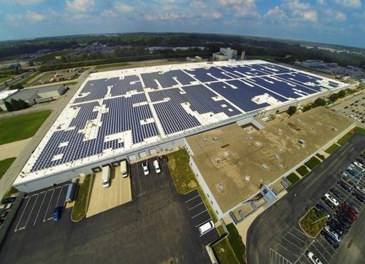 Bifacial solar panels on white membrane roof
