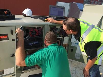Melink technician diagnosing HVAC unit